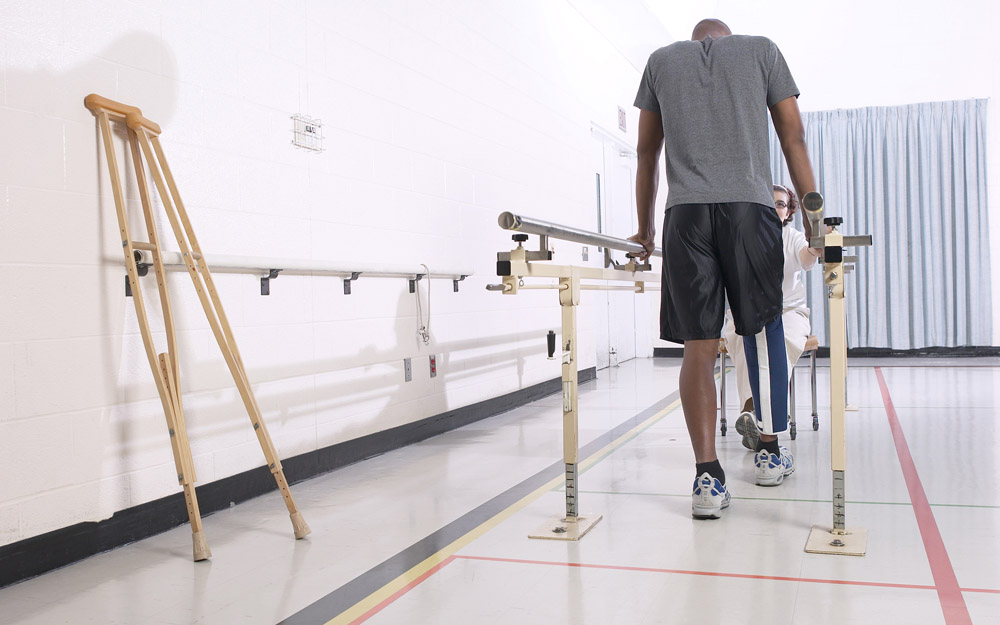 An African-American man with an injured leg doing physical therapy