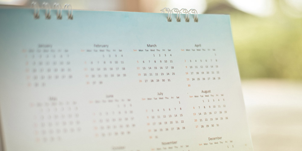 a desk calendar in soft light