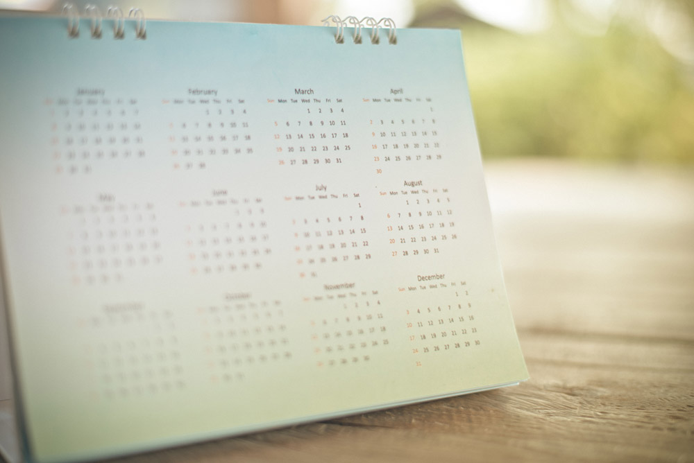 a desk calendar sitting in soft light