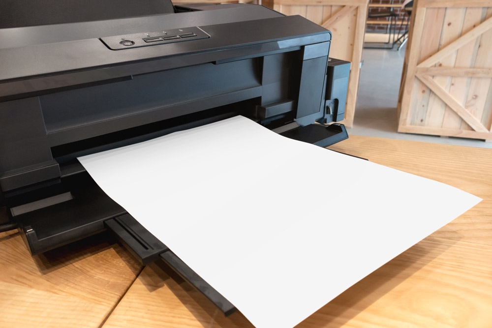 A printer with paper loaded in the tray