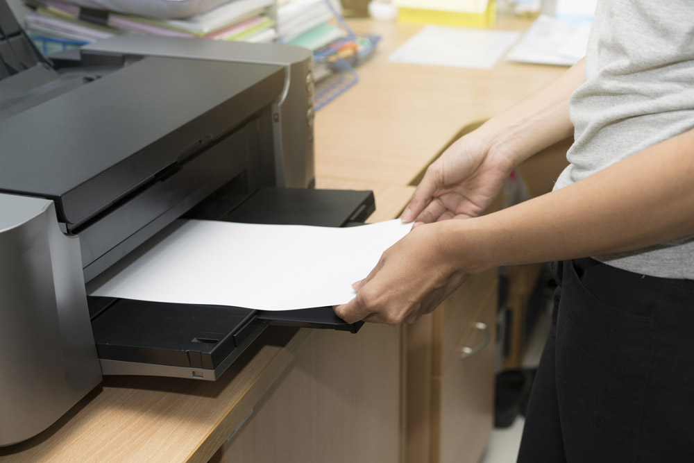 a printer with paper in the tray